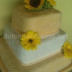 torta con girasoles y herberas